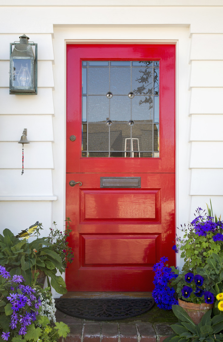 Red is a super trendy color for your front door. Here are some welcoming front door colors to inspire you!