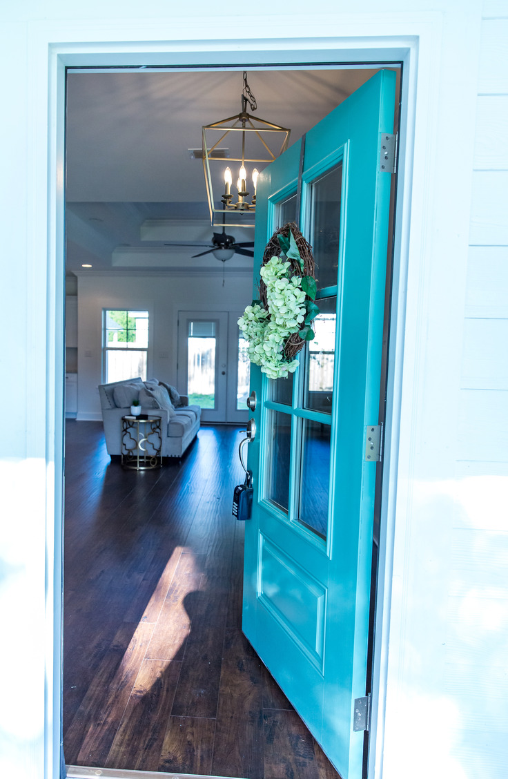 Turquoise is always a beautiful front door color. Here are some welcoming front door colors to inspire you!