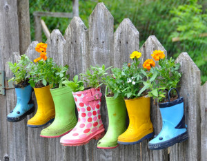 Darling idea for a kids garden using old rubber boots in bright colors.
