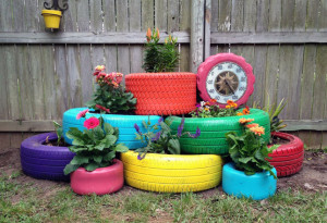 old tires painted with bright colors make a unique alternative for container gardening