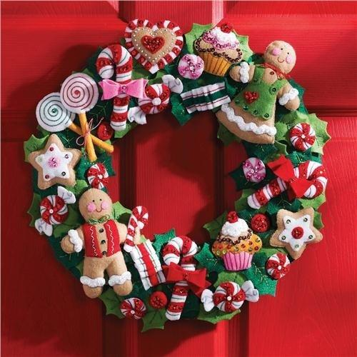 make a wreath out of wonderful felt decorations that look like all sorts of christmas goodies candy canes gingerbread men cupcakes and any other