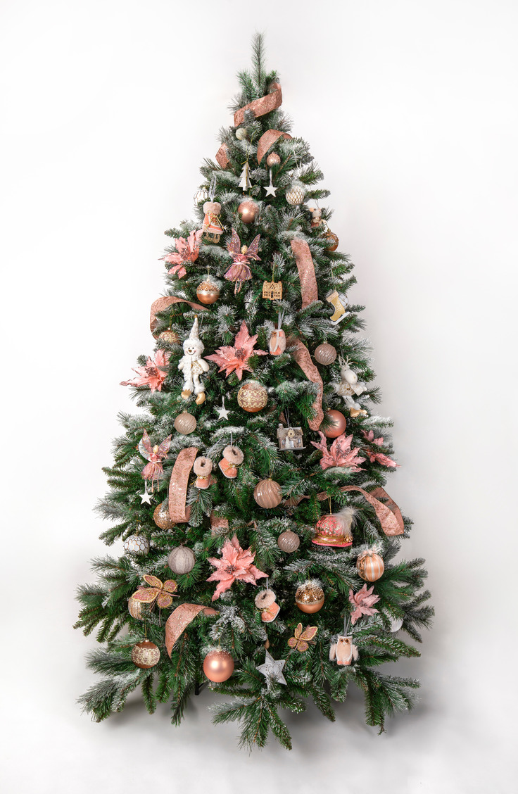 Here are some great ways to decorate a Christmas tree. The ribbon and some of the ornaments are a muted red tone, which is a fun change of pace from a bright fire engine red.