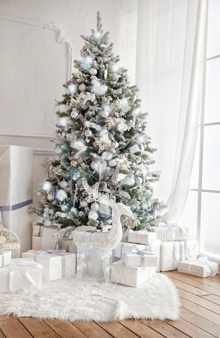 Here are some great ways to decorate a Christmas tree. There's something so alluring about an all-white Christmas tree! This particular beauty is flocked, and most of the ornaments are white.