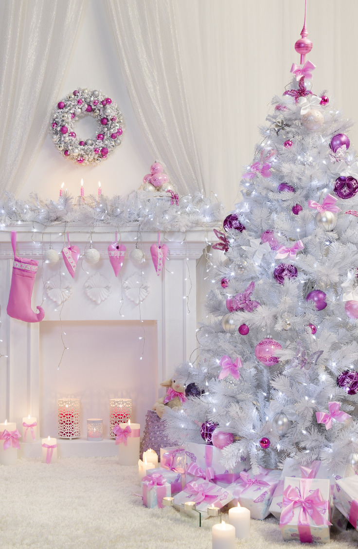 Here are some great ways to decorate a Christmas tree. Like a tree with romantic vibe? This beautiful flocked tree features ribbon bows and ornaments in lovely shades of pink and purple. It's definitely something different!