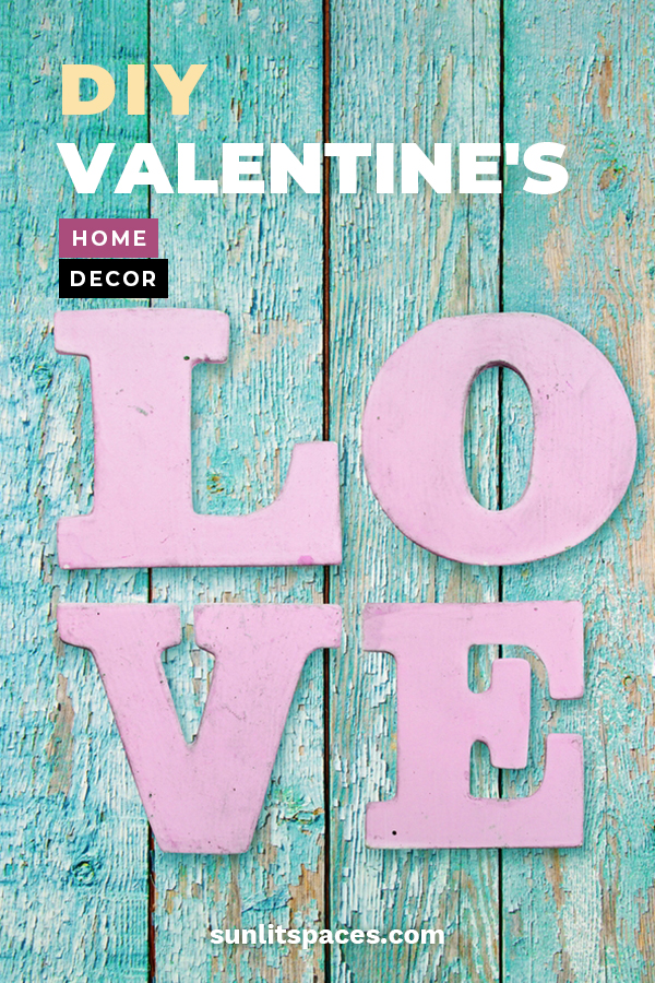 Decorate your house this year for Valentine's Day with this easy to do DIY decor ideas made out of wood. All types of decor for all types of DIY levels. Decorate your mantel with wood blocks, door hangers, garland and more. Show your LOVE of the holiday and say WOOD you be mine with these darling decor ideas. For more info, keep on reading. #wooddiyvalentinesdecor #holidayhomedecor #diyholidaydecor