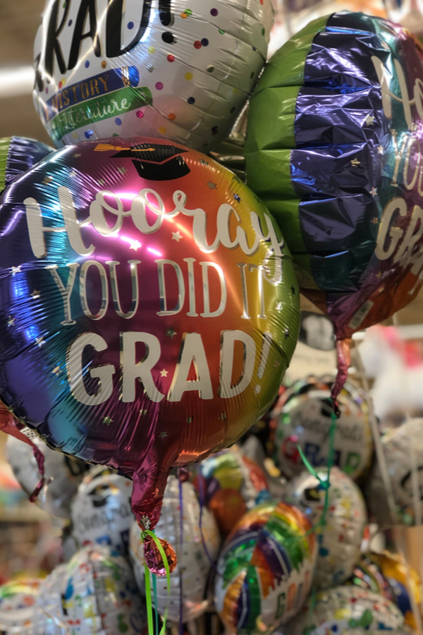 A grad brag board and tables is a unique way to celebrate your graduate. Set up a grad brag board and table so the family can celebrate all the month of May! Don't forget the balloons!
