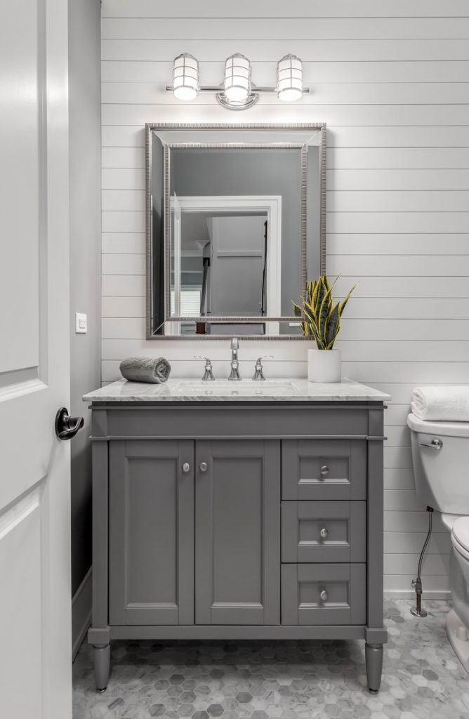 Shiplap isn't just a plain Jane way to cover a wall. Shiplap is more versatile than you may think. Learn how to use shiplap in your bathroom!
