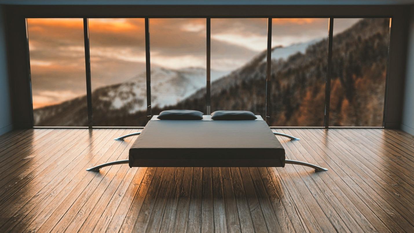 A mattress placed on a wooden floor